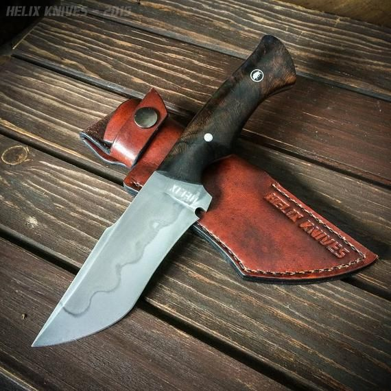 The Blade Is Made Out Of 1095 Carbon Steel It Has A Etched And Polished Finish Which Reveals The Hamon In The Steel The Handle Hunting Knife Knife Cool Knives