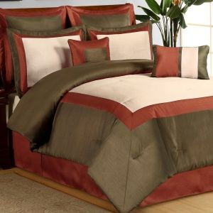The Hotel Rust Comforter Set has corded edging and includes a Comfo...
