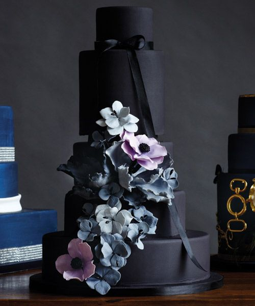 Dark chocolate cake with passion fruit–flavoured buttercream, floral details, handmade and hand-dusted gum paste parrot tulips and anemone