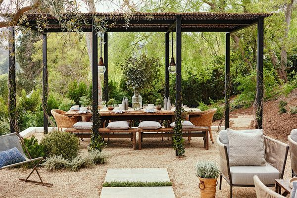 """Julianne Hough Gives Her Outdoor Space a Chic Makeover: """"I love my pergola which has a hand woven roof that adds so much character to my yard and keeps my friends and I shaded during our big feasts."""""""