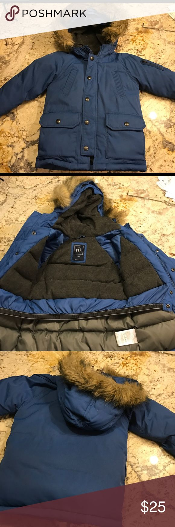 GAP boys winter coat Beautiful, thick, warm quality winter coat from GAP kids. Size 4. Lots of pockets and the fur on the hood can come off (it's on with buttons). Super warm - perfect for cold winters! GAP Jackets & Coats