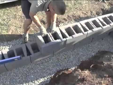 Do it yourself video -How to build your own retaining wall for your home or busi…