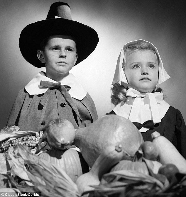 A boy and girl pose in their Thanksgiving costumes with a harvest table arrangement in the 1950s. #vintage #Thanksgiving #holidays #1950s