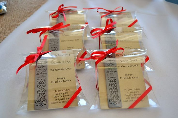 LARISSA - Confirmation bookmarks presented in pillow boxes with thank you card insert and finished with red satin ribbon