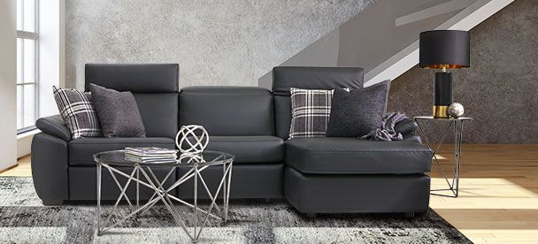 Black leather sectional with recliner seats. Venice model from the Optima collection. By Jaymar.