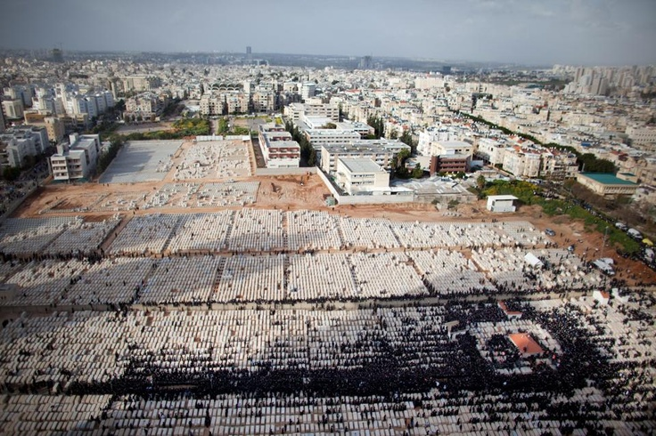 """""""Thousands of ultra-Orthodox Jews of the Vizhnitz Hasidic dynasty take part in the funeral of their rabbi Moshe Yhoshua Hager at a cemetery on March 14, 2012. in Bnei Brak, Israel."""""""