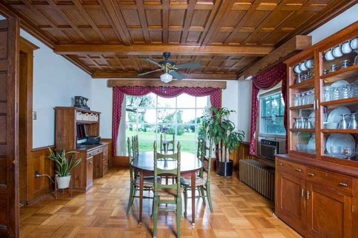 """Charming Arts & Crafts Home with over 2 gently rolling acres convenient to city amenities! Original """"mint condition"""" woodwork throughout this circa 1915 home, with modern-day conveniences including an updated kitchen, refinished hardwood floors, built-ins, and new metal roof"""