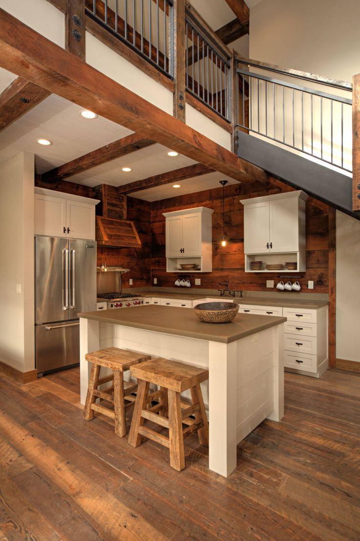 Cucina in stile rustico di Uptic Studios