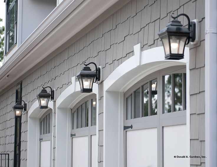 Trend Watch: Gray is the New Neutral! #Gray shingle siding with white trim and #iron lanterns on a three-car #garage. See more on our House Plans Blog http://houseplansblog.dongardner.com/trend-watch-gray-new-neutral/