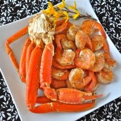 Steamed Alaskan snow crab legs and shrimp