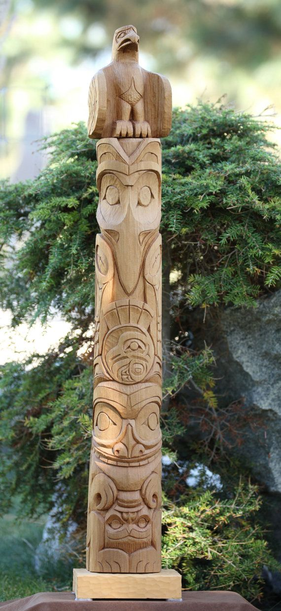 This wonderful totem pole was carved in old growth Western Red Cedar. It stands proudly at 34 (almost 3 feet) tall and is 4 x 4 in diameter. It was