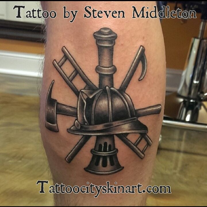 fireman symbol black and grey realistic tattoo by Steven Middleton, Lockport, IL. Tattoocityskinart.com