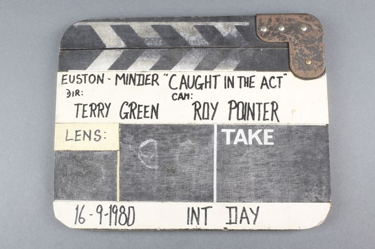 """Lot 212, A wooden clapper board used on the Minder series, marked Euston-Minder """"Caught In The Act"""" DIR Terry Green, CAM Roy Pointer, 16/9/1980 INT Day sold for £95"""