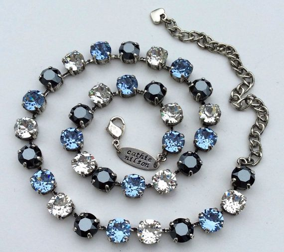 Beautiful combination of Lt. Sapphire Blue, Clear Crystal and Hematite Stones in an Antique Silver setting
