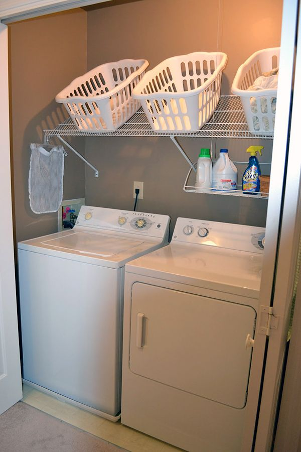 I love this shelf idea for dirty laundry baskets!! Awesome Ideas for Tiny Laundry Spaces