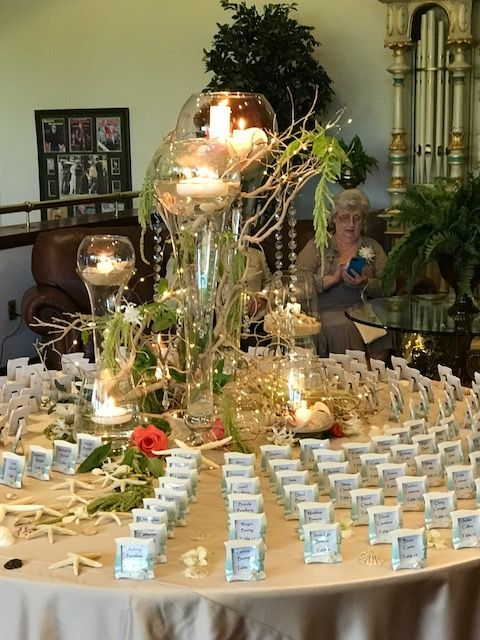 A dynamic beach theme display to welcome Chelsey and Charles' wedding at White Clay Creek Country Club.