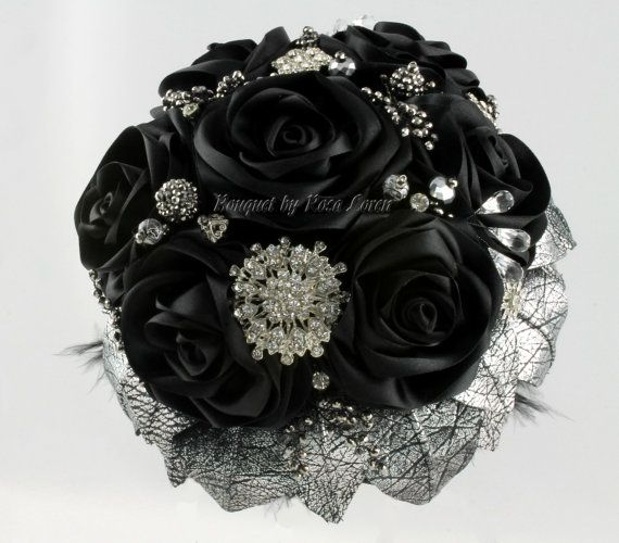 Black satin rose bouquet with silver leather leaves and lots of bling. Rosa Loren Bridal.