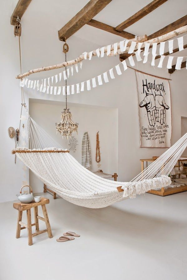 = white bunting, hung branch on industrial pulleys and hammock