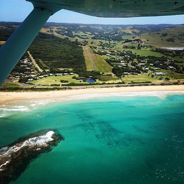 Flying over Apollo Bay on the @greatoceanroad in #Victoria - looks like a nice day to land and take a stroll along the beach! This seaside village is one of many stop-overs along this famous driving route, and is a great base for exploring the vast Otway Ranges. Photo: @joshb6