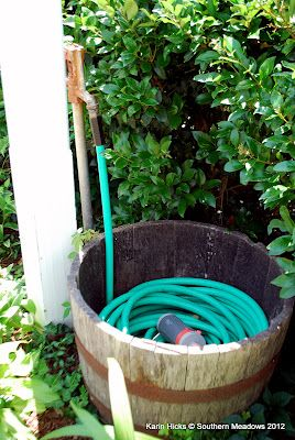 whiskey barrel for hose storage @Southern Meadows