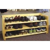 Make it yourself - WorkshopSupply.com  has a plan for a Stackable Shoe Stand - each layer stacks on top of the next. You can go from floor to ceiling if you want to.