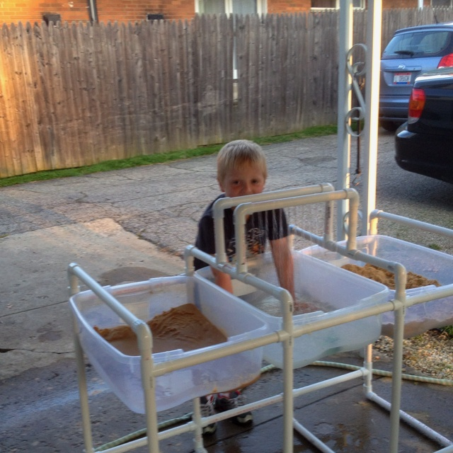 water and sand table i made using pvc and storage bins