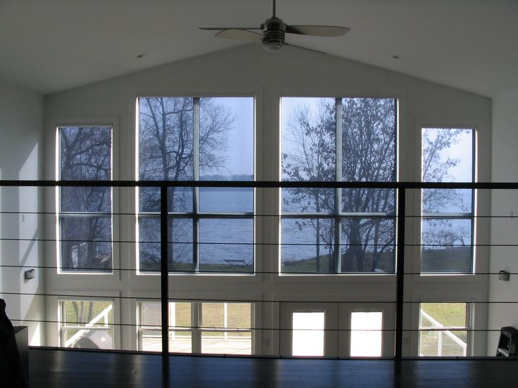 Our customer did not want to ruin his view of the lake, but needed Sun protection on his upper windows. He ordered and installed our Grey/Silver Embossed shades, wireless motorized with white valance cassette. As you can see he kept his beautiful view but blocked 82% of Sun's heat, 91% of glare and 99% of UV light. Nice eh!