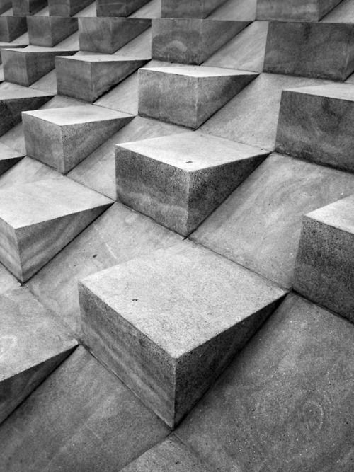 CONCRETE CONSTRUCTION Bold Bauhaus spirit / Dark greys bring a heavy depth to prints / Oversized geometric structures / Big stone blocks build intense concrete zones / Interlocking 3-D shapes / Matte grey terrazzo panels also mimicked in digital form / Minimal, moody and weight