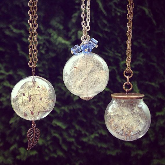 Glass pendants with dandelion seeds in antique brass chain.  The glass globe is about 1 inch. The chain is about 22 inches. You can choose any of the