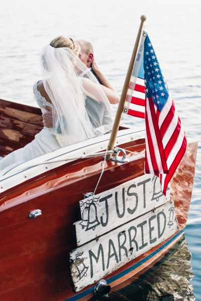Just married boat: http://www.stylemepretty.com/2014/12/04/rustic-summer-wedding-at-migis-lodge/ | Photography: Justin & Mary - http://justinmarantz.com/