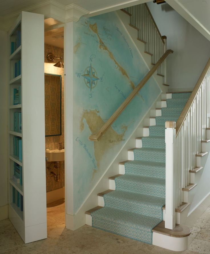 House Tour: Bahamas, Marshall Watson-Style. bookcase open to powder room? Love the Bahamas map on the staircase wall.