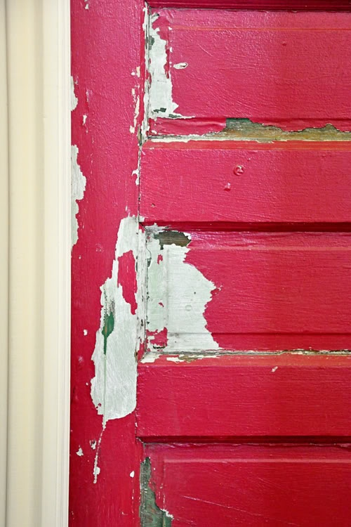 better view of this distressed door. This red almost looks like hot pink?