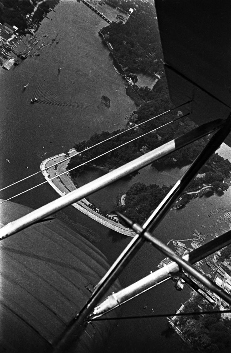 """Arms of the Neva river, 1931. On the left, on Krestovsk island, is the regional sailing club. On the right, on Yelagin island, Kirov Park is under construction. From a series of photos of Leningrad from the air, taken for the magazine """"USSR in Construction"""". Russia"""