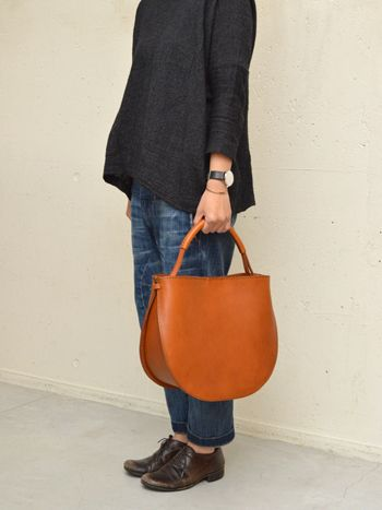 Medium (34 cm x 28 cm x 19 cm) $??? Organ Leather Circle bag with handles attached on the inside, side panel wraps all the way around and can open to allow for more space