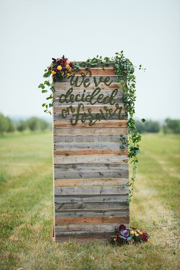 """Summer Harvest wedding inspiration wood palette ceremony backdrop with moss lettering """"we've decided on forever"""" - wedding rental available in Colorado"""