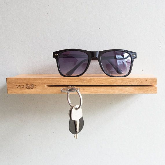 Keyholder made from wood, easy to install, elegant and functional. Accommodates (Sun)glasses, phone, wallet or other essentials