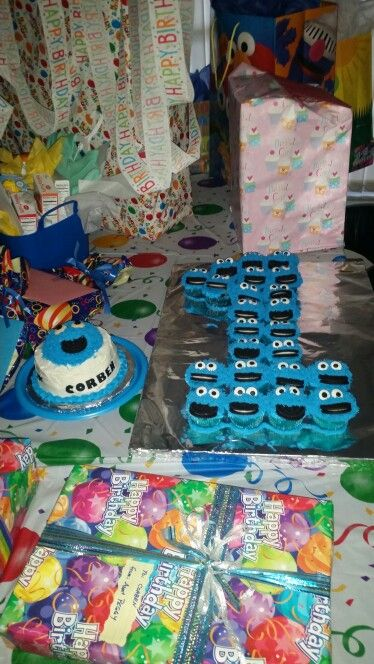 Corben's 1st birthday! Cookie monster cupcakes and smash cake.
