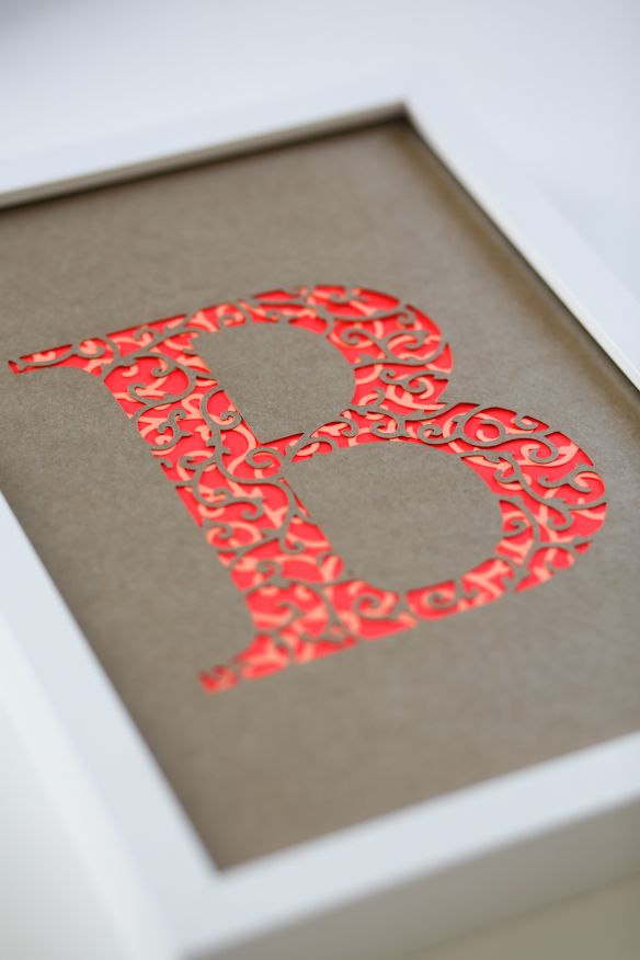 Try this using Silhouette Cameo.  Framed embellished initial. Monogram