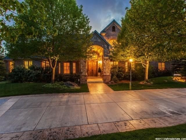 10228 S Altavilla Dr E, Sandy, UT 84092 — Magical near two-acre estate, with gorgeous meticulously landscaped  yard with heated pool, pond, garden house,  and views across Dimple Equestrian to the snow capped mountains of Snowbird. Quality Brad Reynolds built brick and stone two story with soaring vaults, main floor master, gourmet kitchen, large open spaces, theater and indoor sports court. This family dream home is surrounded by stone walls, 200 trees of all types, garden house and breeze…