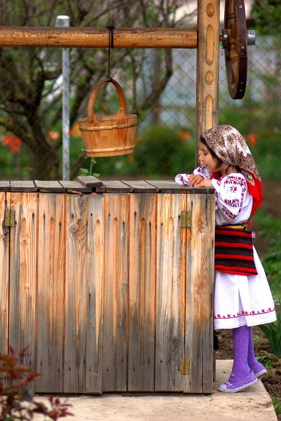 Romanian girl with traditional costume. www.haisitu.ro