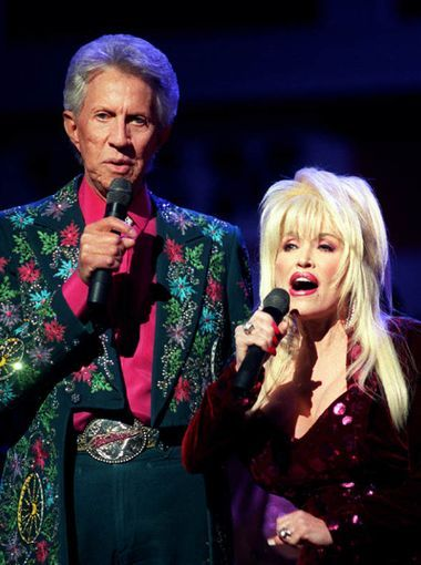 Porter Wagoner, left, celebrates his 50th anniversary as an entertainer with help from former duet partner Dolly Parton.