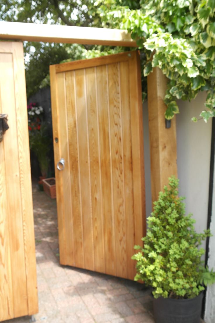 Popular garden gate design - The Guildford. Flat top design with vertically cladded boards set within a deep 70mm x 70mm frame. Constructed from softwood pine using traditional mortise tenon and dowel joints.