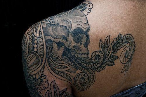 skull shoulder tattoo. love detailed skull tattoos