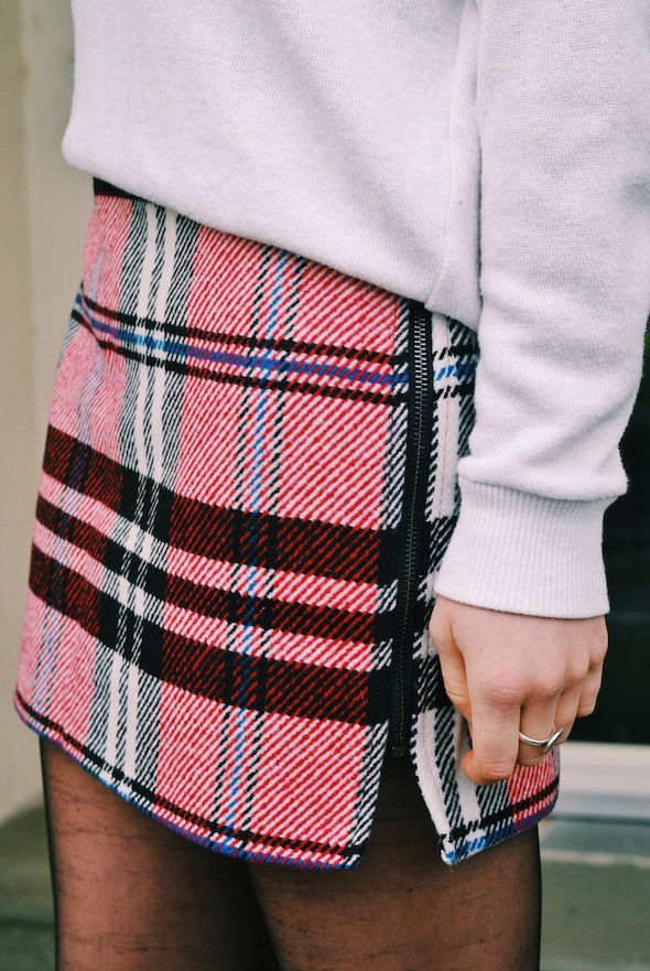 plaid skirt with a sweater/sweatshirt and tights