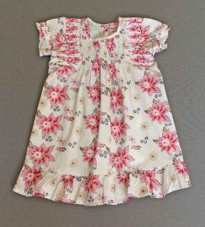 Spantajaparos. Vestido de flores rosas y azules con volantito en el bajo