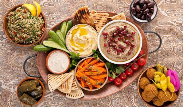 Middle Eastern Party Platter: Baba Ghanouj Hummus with Roasted Garlic Falafel Tahini Sauce  Carrot Salad with Citrus Dressing  Classic Tabbouleh Grilled whole wheat pitas, cut in triangles Cherries tomatoes Baby cucumbers Black olives Parsley, for garnishing