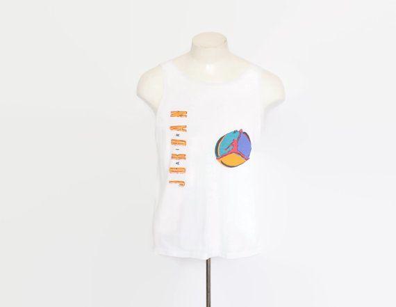 vintage late 80s nike air jordan tank top. white cotton with air jordan logo on front. nike swoosh logo on back in red.  #vintagemenswear #mensvintage #mensfashion #toughluckvintage