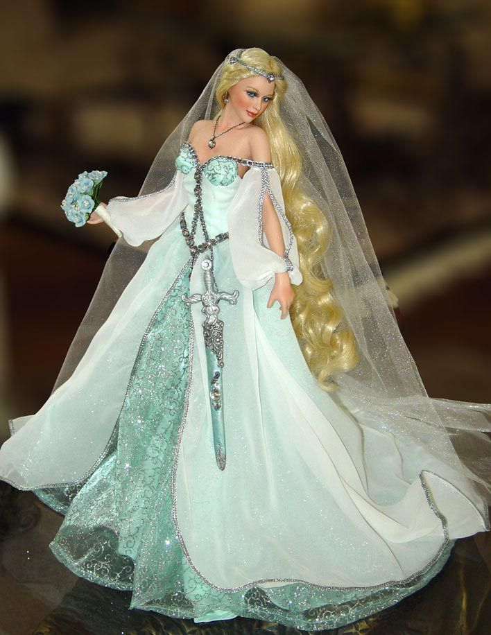Legendary Bride Series 2003 – 2004: Lady of the Lake Bride by Cindy McClure. Lady of the Lake remains the number one most sought after Bride doll by Cindy McClure. Secondary market value is approximately $1200-$1600. EXTREMELY RARE, as this was the third doll in the series and not many produced.