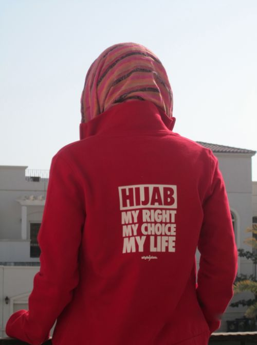 Woman in Jacket that Reads: Hijab, My Right, My Choice, My Life