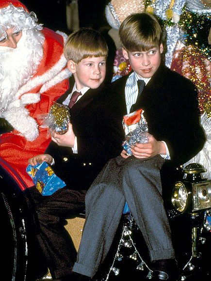 Prince William and Prince Harry spending time with Santa in 1990, following a visit to the Horse of the Year show with their mother.